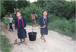 Lao Hue children bringing water from river to their home