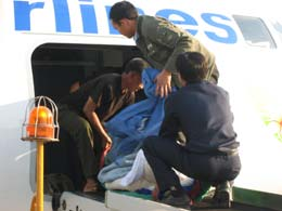 Airlifting Pheng in to Vientiane