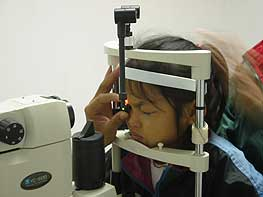 Vang receiving the laser surgery