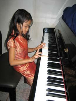 Vang studying piano